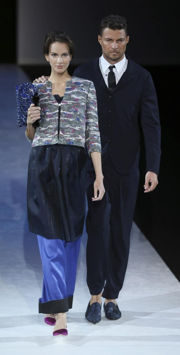 Models wear creations for Giorgio Armani men`s Spring-Summer 2014 collection, part of the Milan Fashion Week, unveiled in Milan, Italy.