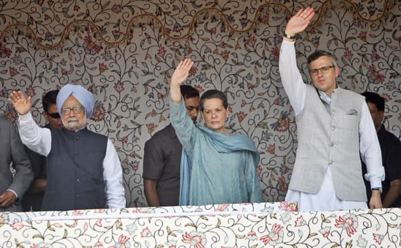 Prime Minister Manmohan Singh, Congress Party President Sonia Gandhi and Chief Minster Jammu and Kashmir Omar Abdullah wave to the crowd during the foundation stone lying ceremony of the 850 MW Rattle hydro power project in Kishtwar district of the Jammu.