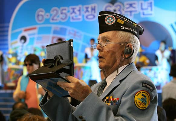 US veteran Leo G. Ruffing from Portsmouth, Va., uses a tablet PC to takes pictures during a ceremony to mark the 63rd anniversary of the outbreak of the Korean War in Seoul, South Korea.