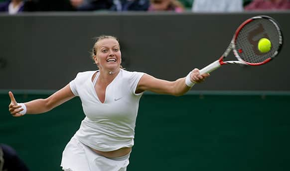 Petra Kvitova of the Czech Republic returns to Coco Vandeweghe of the United States during their Women`s first round singles match at the All England Lawn Tennis Championships in Wimbledon, London.