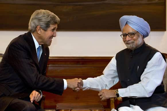 US Secretary of State John Kerry, shakes hands with Indian Prime Minister Manmohan Singh during their meeting at the prime minister`s residence in New Delhi.