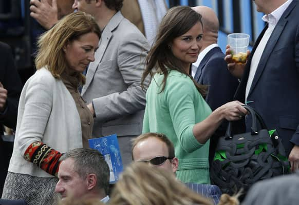 Pippa Middleton, right, and Carole Middleton, sister and mother of Kate,the Duchess of Cambridge, arrive to watch the tennis match between Britain`s Andy Murray and Nicolas Mahut of France, on the centre court at Queen`s Club grass court championships in London.