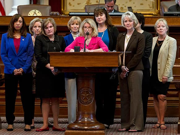Rep. Jodie Laubenberg, R-Parker, center, sponsor of Senate Bill 5, is flanked by fellow Republicans during the second reading of the abortion bill on the House floor of the Texas State Capitol in Austin, Texas.