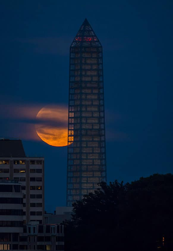 The moon rises behind the Washington Monument. The so-called supermoon appeared up to 14 percent larger than normal as our celestial neighbor swung closer to Earth, reaching its closest distance early Sunday morning.