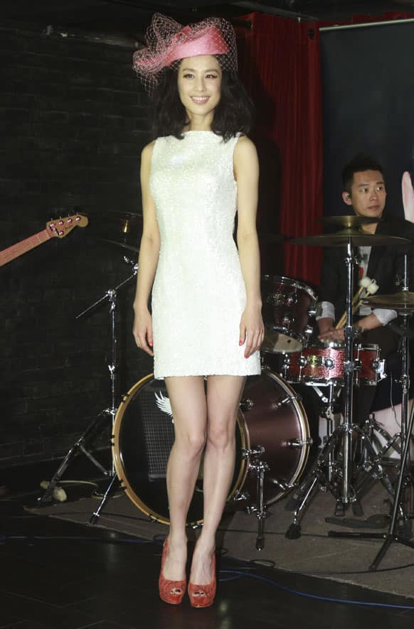 Chinese singer Eva Huang poses for photos during a media event promoting her new album