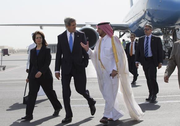 US Ambassador to Qatar Susan Ziadeh walks with US Secretary of State John Kerry and Ambassador Ibrahim Fakhroo, Qatari Chief of Protocol, on Kerry`s arrival in Doha, Qatar.