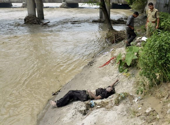 A body is found lying on the ground after floodwaters began receding at Ganga Ghat.