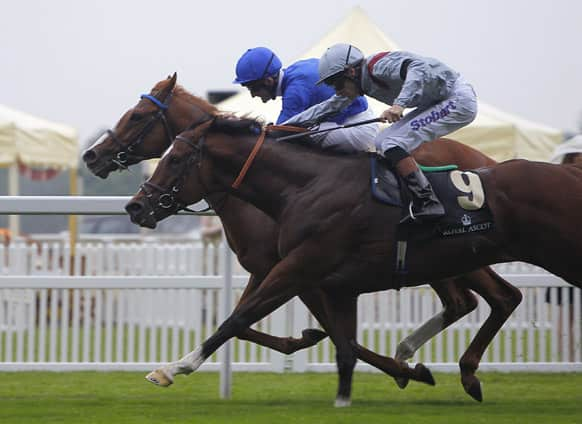 Dawn Approach ridden by Kevin Manning, left, races past Toronado ridden by Richard Hughes to win thee St James`s Palace Stakes aheadduring day one of the Royal Ascot meeting at Ascot Racecourse, Ascot England.