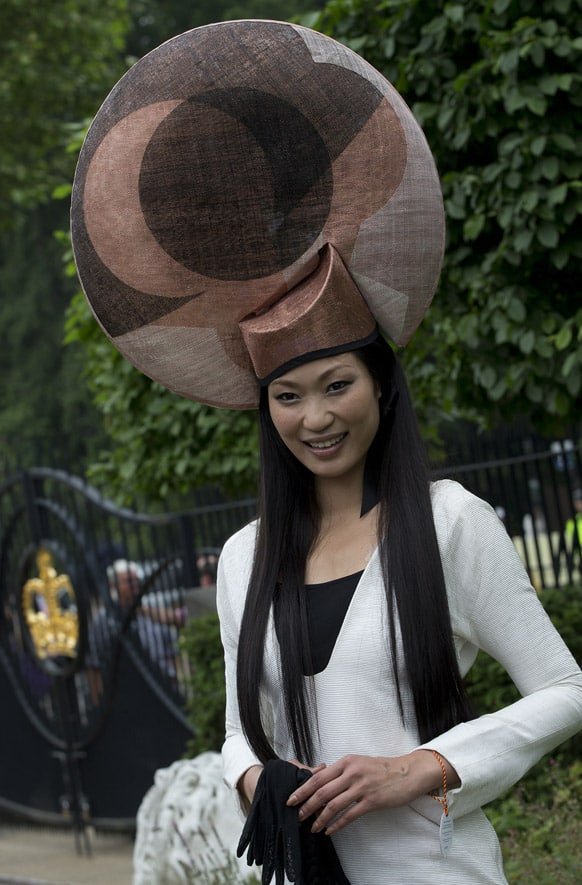 Wei Lin from Taiwan wears an ornate hat on the third day traditionally known as Ladies Day of the Royal Ascot horse race meeting in Ascot, England.