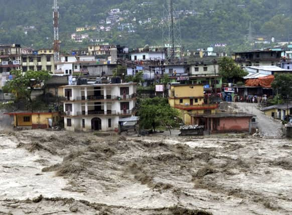 Houses are partly submerged in the flooded River Ganges in Uttarakashi district, in the northern Indian state of Uttarakhand.