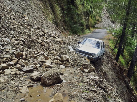 A car is abandoned in rubble from a landslide in Tehri, the northern Indian state of Uttarakhand.