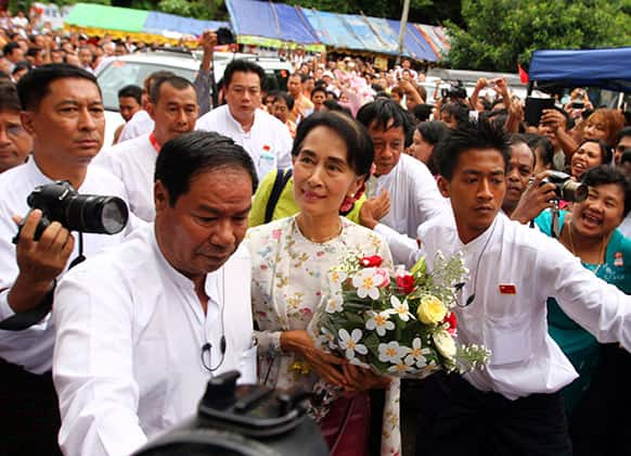 Myanmar opposition leader Aung San Suu Kyi arrives to attend a ceremony to mark her 68th birthday at the headquarters of her National League for Democracy (NLD) party in Yangon, Myanmar.