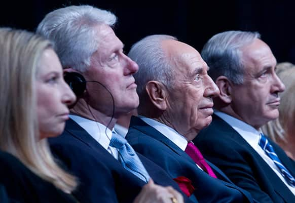 Israeli President Shimon Peres sits with former US President Bill Clinton during Peres` 90th birthday gala in Jerusalem.