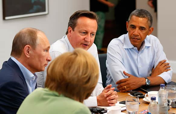 G8 leaders from left, German Chancellor Angela Merkel, Russian President Vladimir Putin, Britain`s Prime Minister David Cameron and US President Barack Obama attend a working session during the G-8 summit at the Lough Erne golf resort in Enniskillen, Northern Ireland.
