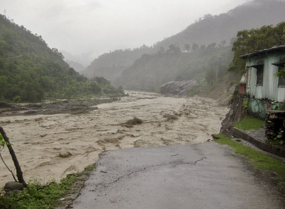 Flooded Badrinath highway road is seen near Joshimath district in northern Indian state of Uttarakhand.
