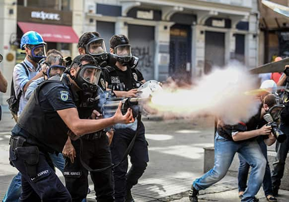 Police fire tear gas as riot police spray water cannon at demonstrators who remained defiant after authorities evicted activists from an Istanbul park, making clear they are taking a hardline against attempts to rekindle protests that have shaken the country, near city`s main Taksim Square.