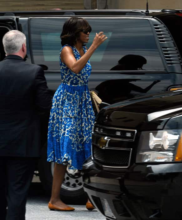 First lady Michelle Obama arrives at the Strathmore Music Center in Bethesda., Md., to attend daughter Sasha Obama`s recial.