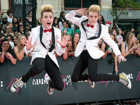 Jedward pose on the red carpet during the 2013 MuchMusic Video Awards in Toronto.