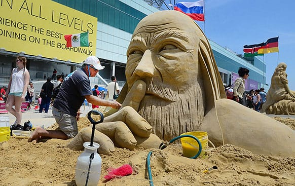 Sculptor Matt Long of Staten Island New York, an original cast member of the Travel Channel TV show, `Sand Masters,` works on his entry,  during the World Championship of Sand Sculpting on the beach next to the Pier at Caesars in Atlantic City, N.J.