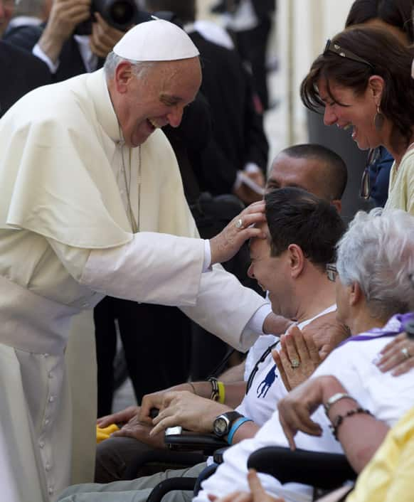 Pope Francis blesses sick and disabled people at the end of a pro-life Mass in St. Peter`s Square, at the Vatican.