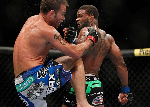 Tyron Woodley, right, connects to the head of Jake Shields, left, with a reverse punch during their welterweight bout at UFC 161 in Winnipeg.