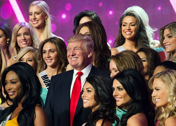 Donald Trump, co-owner of the Miss Universe Organization, poses for a photo with the competitors during rehearsal for the upcoming Miss USA Competition at PH Live in Las Vegas.