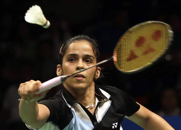 Saina Nehwal  returns the shuttlecock to Germany`s Julianne Schenk during their women`s singles semifinal match at the Indonesia Open badminton championship at Istora stadium in Jakarta.