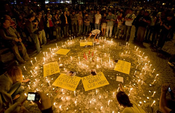 People light candles for the victims of the protests at Taksim square, in Istanbul.