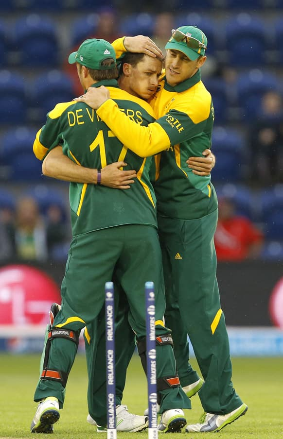 South Africa`s Dale Steyn is congratulated after bowling West Indies` Marlon Samuels during an ICC Champions Trophy cricket match between West Indies and South Africa at the Cardiff Wales Stadium in Cardiff.