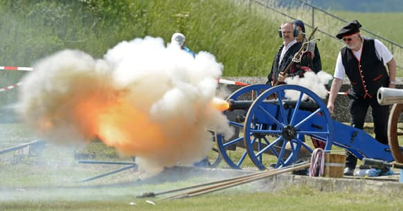 A participant fires off a historical cannon during the International Championships of field artillery gunners near Sondershausen, central Germany.
