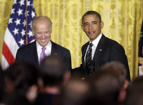 President Barack Obama with Vice President Joe Biden, on stage speaking at a reception in the East Room of the White House in Washington to celebrate lesbian, gay, bisexual, and transgender (LGBT) Pride month, Washington.