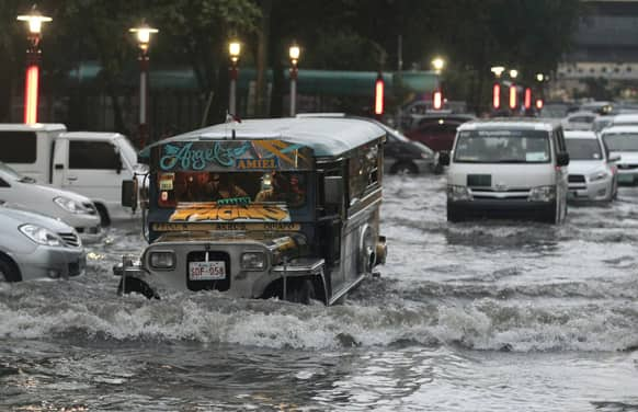 A passenger jeep crosses a flooded street in Manila, Philippines. Heavy rains caused classes to be suspended in Manila and disrupt traffic on flooded streets.