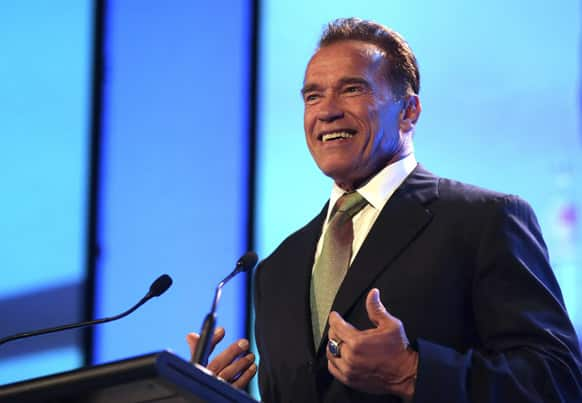 Former Governor of California Arnold Schwarzenegger gestures while he delivers a speech during a Financial Education Summit in Sydney, Australia.