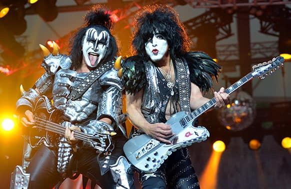 Bassist Gene Simmins, left, and singer Paul Stanley of the US band Kiss perform on stage in Berlin, Germany. It is the only concert of the rock group in Germany during their Monster Tour 2013.