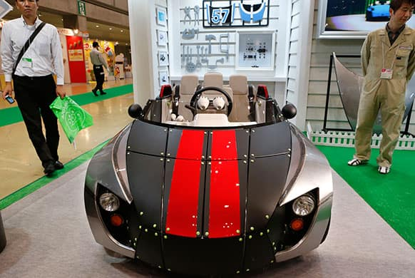 Toyota Motor Co.`s Camatte 57s electric car is displayed at the Tokyo Toy Show in Tokyo. Toyota designed the three-seater concept car for children to drive only on private property.