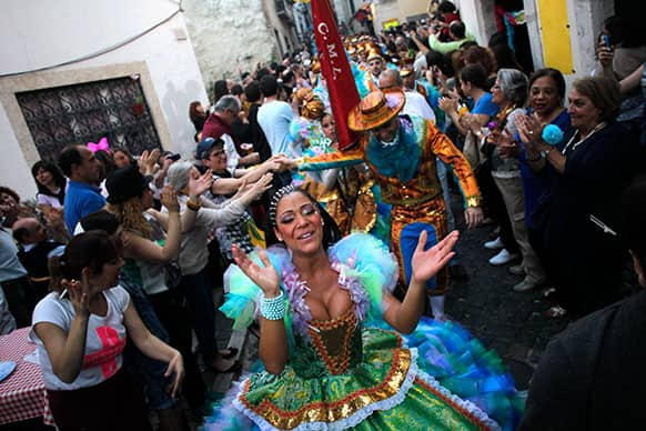 Dancers of the Alfama neighborhood group are greeted as they preapre to take part in Lisbon`s popular marches contest during Saint Anthony festivities, in Lisbon.