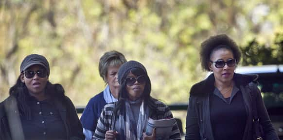 Granddaughters Zaziwe Manaway, left, Zoleka Mandela, centre, and daughter Zenani Dlamini, right, arrive at the Mediclinic Heart Hospital where former South African presidentNelson Mandela is being treated, in Pretoria, South Africa.