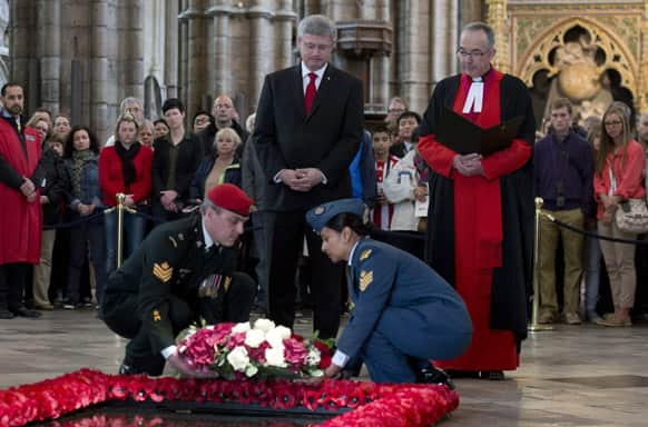 Dean of Westminster Abbey Dr. John Hall, right, stands with Canadian Prime Minister Stephen Harper as a wreath is laid by members of the Canadian Forces at the Tomb of the Unknown Warrior in Westminster Abbey in London.