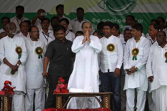 Naveen Patnaik, President of Biju Janata Dal or BJD, and CM of the eastern Indian state of Orissa, greets his supporters at a rally demanding special status for the state of Orissa in New Delhi.