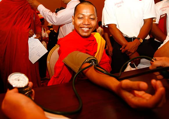 A Cambodian Buddhist monk receives blood-pressure check during a blood donation campaign joined by more than 500 people ahead of the 10th World Blood Donor Day in Phnom Penh, Cambodia.