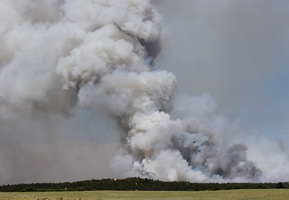 A fire burns out of control north of Shoupe Road and East of Highway 83 in Colorado Springs, Colo.