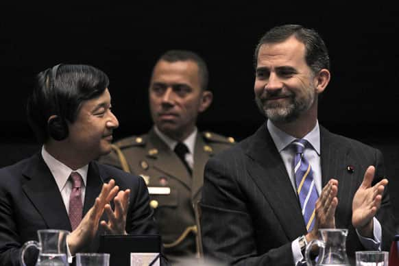 Spain`s Crown Prince Felipe, right, and Japan`s Crown Prince Naruhito, left, clap hands during the opening of Spanish-Japanese Business Cooperation Meeting at the House of Mint in Madrid.