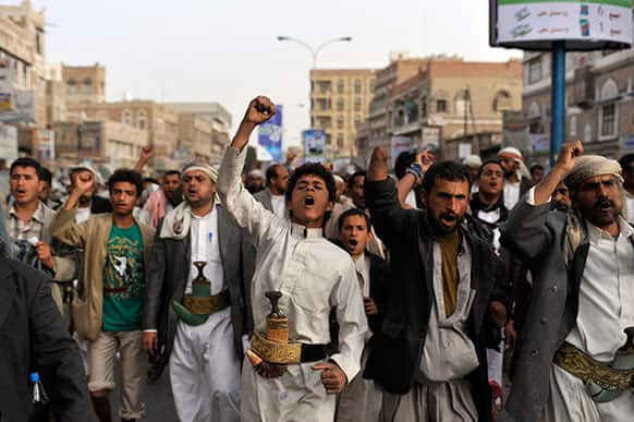 Yemeni Shiite Hawthis chant slogans as they march during a demonstration demanding the release of political detainees near intelligence headquarters in Sanaa, Yemen.