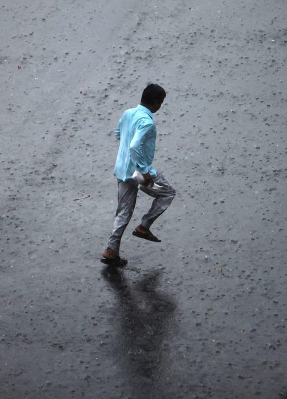 A man runs during a sudden rain in Hyderabad.