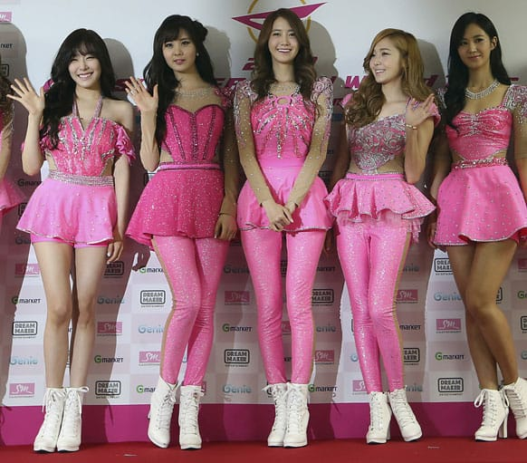 South Korean K-pop girl group Girls` Generation poses for photographers during a news conference for their world tour in Seoul, South Korea.