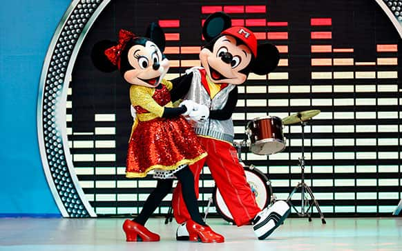 Popular Disney characters Minnie Mouse, left, and Micky Mouse perform during