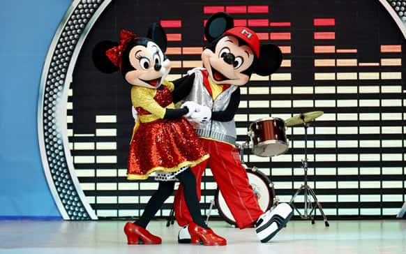 Popular Disney characters Minnie Mouse and Micky Mouse perform during