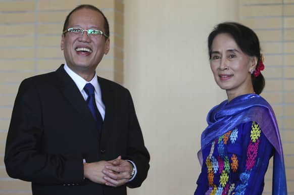 Philippine President Benigno Aquino III, is welcomed by Myanmar opposition leader Aung San Suu Kyi on the sideline of the World Economic Forum which the Philippines will be hosting next year in Naypyitaw, Myanmar.