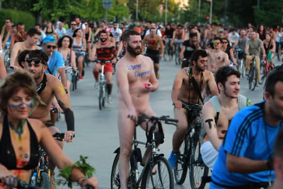 Protesters some naked with their body painted during a bicycle protest in the northern port city of Thessaloniki, Greece.