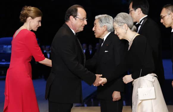 French President Francois Hollande and his partner Valerie Trierweiler are greeted by Japanese Emperor Akihito and Empress Michiko, upon their arrival for a dinner reception at the Imperial Palace in Tokyo.